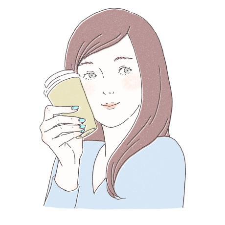 コーヒーの紙ケースを顔の横に添えている写真